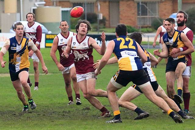 Lion cornered: Inverloch-Kongwak got off to the best start of the two sides but while the Lions drew level by half time, the Sea Eagles regained composure to score a convincing, at home win. Photo courtesy Gerard Bruning-@ fourcornersframing.biz.