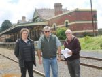 Making a point: from left, Chris Cantlon, David Rasmus and Brian Hess of the South and West Gippsland Transport Group welcome council candidates' support for the return of rail services. They are at the Korumburra Railway Station.