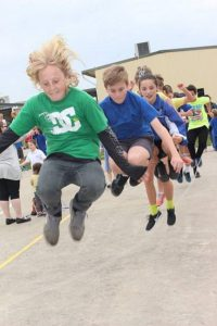 In action: Wonthaggi North Primary School students Troy, Jarvis and Leah got some air during the Jump Rope for Heart jump off recently.