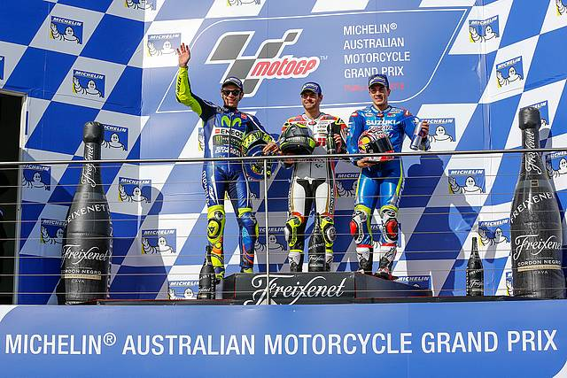 Podium trio: British Honda rider Cal Crutchlow (centre) celebrates his win in the Australian MotoGP on Phillip Island on Sunday with second placed Valentino Rossi (left) and third, Maverick Viñales.