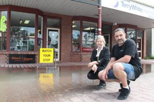 Too much: Michael Chizzoniti and Annie Roylance have shops on River Drive in Tarwin Lower, which in wet weather are impacted by a large puddle.