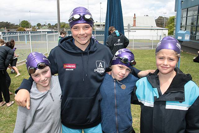 Keeping warm: staying dry before their 10 and Under relay race are South Gippsland Bass members, from left, Oscar Dellamina (Wonthaggi), Tom Niven (Phillip Island), Thomas McKenzie (Leongatha) and Rhett Collins (Leongatha).