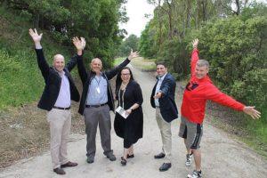 Happy pollies: from left, Gippsland South MP Danny O'Brien, Great Southern Rail Trail committee of management member Bruce Beatson, Eastern Victoria MLC Harriet Shing, South Gippsland Shire Council mayor councillor Ray Argento and CEO Tim Tamlin we all thrilled to be a part of the relaunch of the Great Southern Rail Trail in Fish Creek on Saturday.