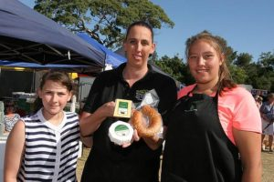 Tastes good: from left, Dakotah Verboon, Nadine Verboon and Hayley Verboon of Wattlebank Park Farm offered cheese, beef, pork, lamb and smallgoods at the Inverloch Lions Club's Twilight Community Farmers Market last Wednesday.